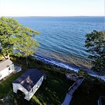 Aerial hotel view of the Oceanfront Cottages, deck and water