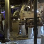 Working watermill and bags of flour