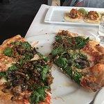 Mushroom and spinach pizza and carnitas tacos