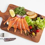 Homemade smoked salmon with Mediterranean salad