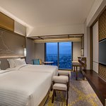 Deluxe Room offers magnificent views of Yangon city, with floor-to-ceiling windows a