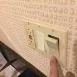 Light switch popping out of socket