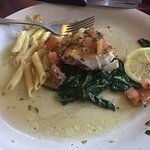 Grilled Cobia over sautéed spinach with penne pasta