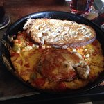 Delightful brunch offerings: eggs Benedict and tomato skillet--each is wonderful