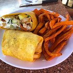 Spicy Chicken Wrap grilled vegetables, goat cheese and hot sauce in a sundried tomato wrap.