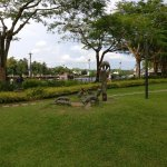 View of Sarawak River from James Brooke Bistro. The playing cats sculpture