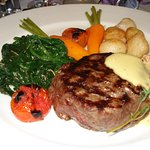 Beef Fillet with sauce Choron, potatoes parisiennes, carrots and spinach