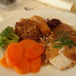 Stuffed Turkey, Chateau Potatoes, vegetables and cranberry sauce