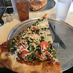 extra large slice of veggie pizza