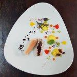 Marinated salmon, black olives, carrot and ginger puree, orange, cucumber.