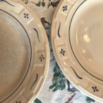 Longaberger Pottery on the left made in China and right made in the USA - shame on Longaberger!