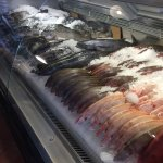 Beautiful fresh seafood market you glance at as you wait through the line