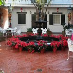 Courtyard with fountain, decorated for Christmas.