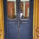 Detail on the doors leading into the courtroom.