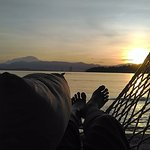 Catch the sunrise by the beach with Mt. Kinabalu on the horizon
