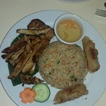 Grilled Pork strips with rice and spring rolls