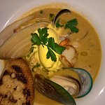 the aromatic seafood broth, with monkfish, baby octopus, shellfish, and saffron creme fraiche