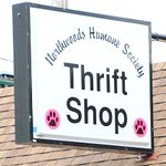 Look for the sign on Third Street with the Pink Paw Logo