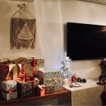 Christmas tree and gifts set up in living room suite