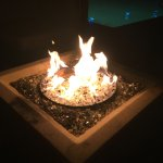 Poolside fire pit at night ... perfect for making s'mores!