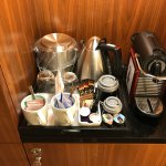Narrow coffee-making area next to the wardrobe.