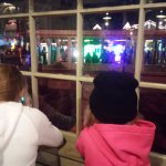 Kids watching parade from Aunt Grannys