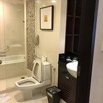 Bathtub with toilet bowl
