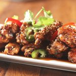 Hurricane Wings Tossed with Sticky Sesame Chili Sauce or Buffalo Style