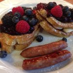 Mixed Berry Stuffed French Toast made with Italian cream cheese, mix berry compote and local sau