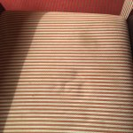 stained chair cushion