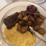 Steak and eggs with cheese