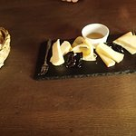 Cheese selection served with flavoured honey