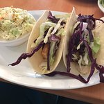 Fish tacos were skimpy. Grilled Romaine was good.