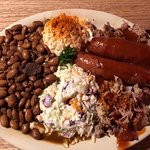 three meat BBQ plate with sides