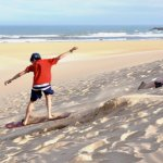Dune Boarding on East Beach! Rent a Duneboard and pick a dune!