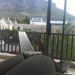 Stunning views from the comfort of a in-room sofa at Ikhaya Lodge, Cape Town sipping Nederburg E