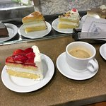 Strawberry sponge cake and black coffee