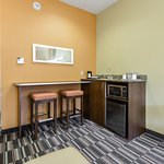 Suite- Eat-in bar in all suites with a coffee maker, refrigerator, and a microwave.