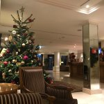 The lobby decorated for Christmas, looking towards the entrance, with the front desk on the righ