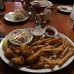 Fried shrimp with fries dips & coleslaw with a Manhattan cocktail