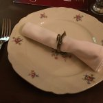 Place setting. Note the napkin ring