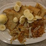 Banana Crepe with a side of hash browns