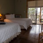 Standard Room with 2 Queen Beds, available with lake view or courtyard views.