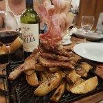 "'Cordoba Patagonia"" (Lamb on potatoes with raw bacon)."