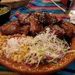 Ribs, coleslaw, corn, rice.