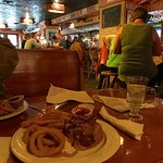 View of the bar/restaurant and our onion rings with tough steak sandwich