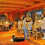 Sharing thanksgiving dinner in the cozy dining lodge with new friends.