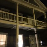 Fleming Veranda front at night. Veranda upstairs and down.