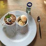 Delicious berry crumble with vanilla ice cream