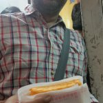 My guide Yateen with a mango ice cream sandwich